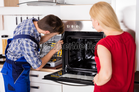 young woman looking at male worker