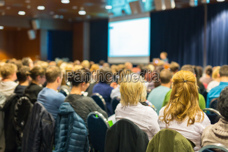 audience in lecture hall participating at