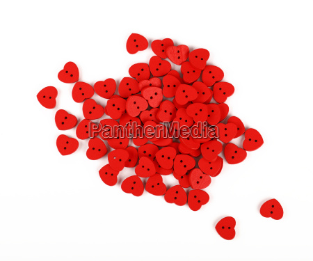 red heart shaped sewing buttons isolated