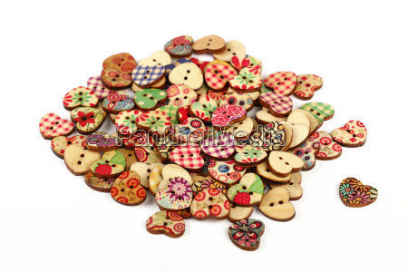 vintage heart shaped sewing buttons over