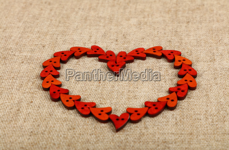 red heart shaped sewing buttons on
