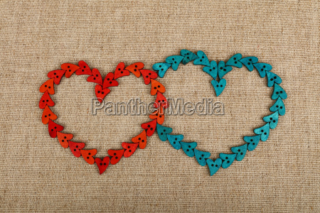 two hearts shaped of sewing buttons