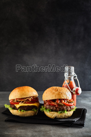 pair of juicy burgers with cheese
