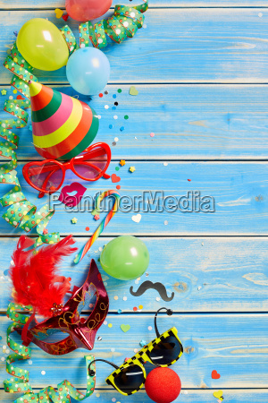 colorful party objects over blue wooden