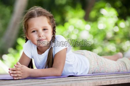 child doing exercise on platform outdoors