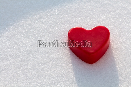 red wax heart in the snow