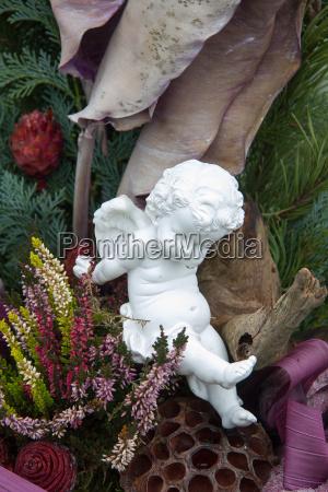 white angel in cutlery as festive