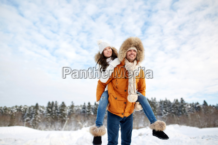 happy couple having fun over winter