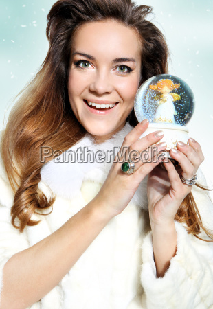 cheerful festive woman in white fur