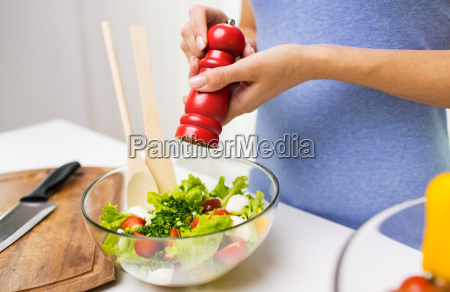 close up of woman cooking vegetable