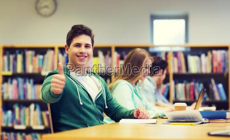 happy student boy preparing to exam