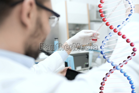close up of scientist with tube