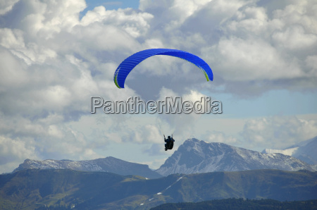 paragliders fly at the wilder kaiser