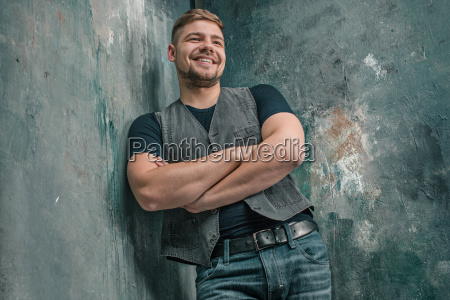 portrait of smiling happy man standing