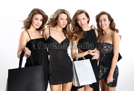women on boutique shopping group of