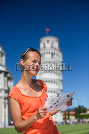 gorgeous female tourist with map admiring