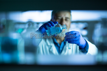 senior male researcher carrying out scientific