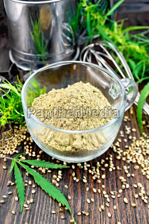 flour hemp in glass cup with