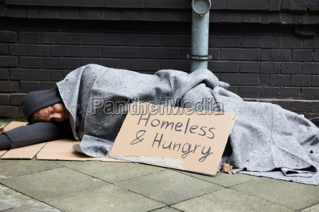 homeless and hungry man sleeping