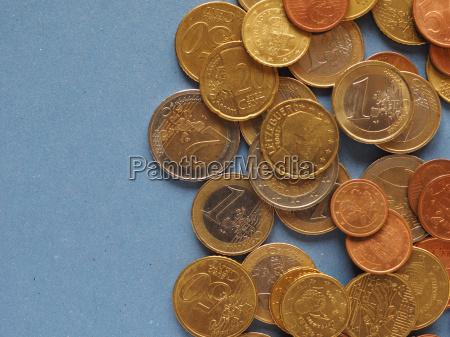 euro coins european union over blue