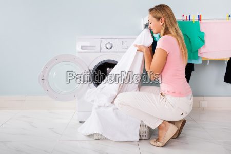 woman with cleaned clothes near the