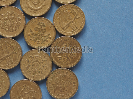 pound coins united kingdom over blue