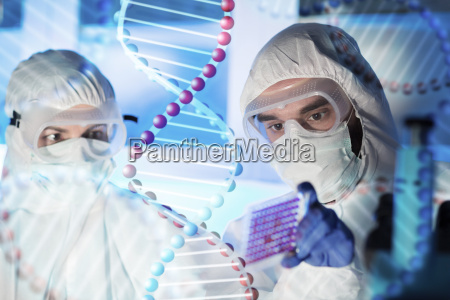 close up of scientists making test