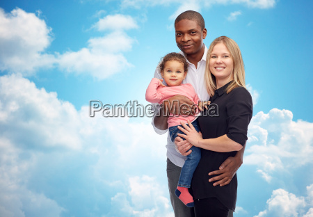 happy multiracial family with little child