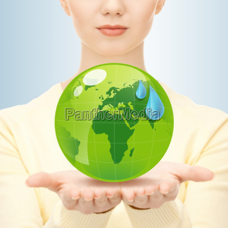 close up of woman holding green