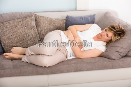 woman sleeping on sofa