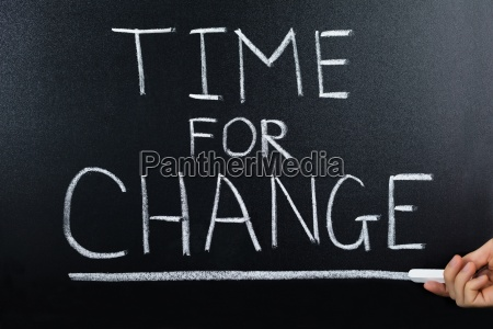 time for change concept on blackboard