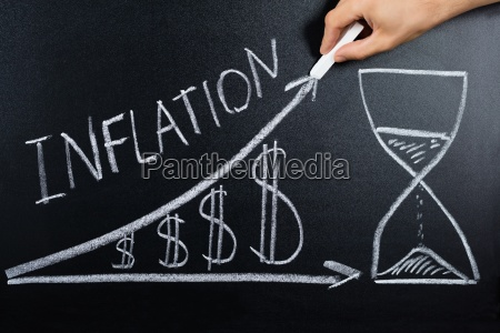 inflation concept drawn on blackboard