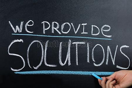 solution concept written on blackboard