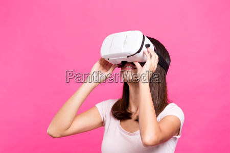 young woman wearing vr device