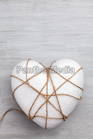heart bound by a string on
