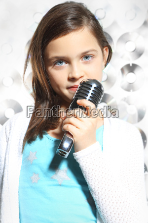 child teen girl singing into a