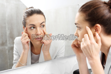 reflection in the mirror woman looks