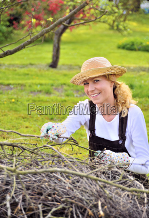 young woman working in orchard after
