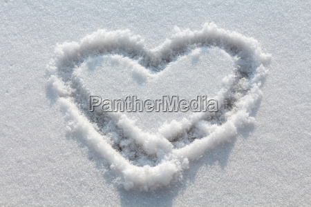 heart drawn in snow
