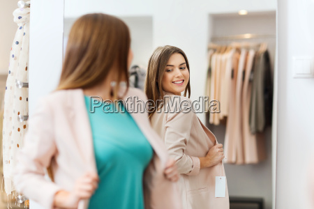 happy woman posing at mirror in