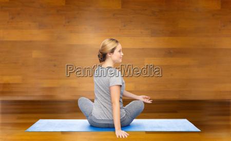 woman making yoga in twist pose