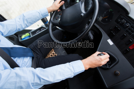 close up of driver driving passenger