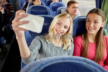 women taking selfie by smartphone in