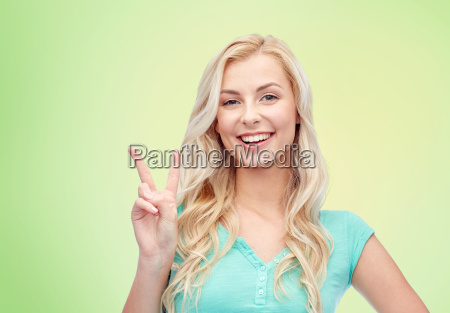 smiling young woman or teenage girl