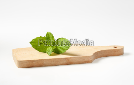 mint leaves on cutting board
