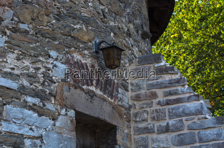 old stone wall with old patterns