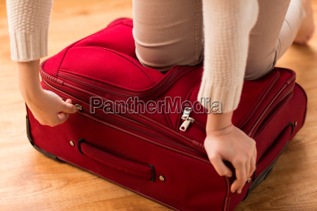 close up of woman packing travel