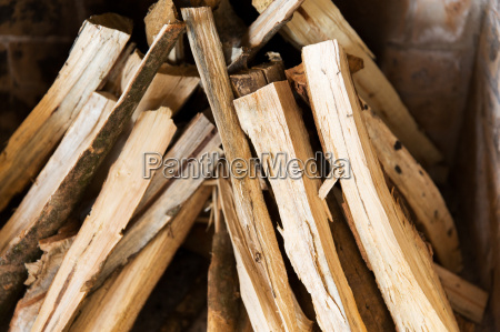 close up of firewood in fireplace