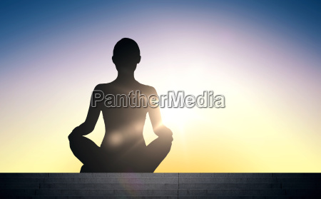woman meditating in yoga lotus pose