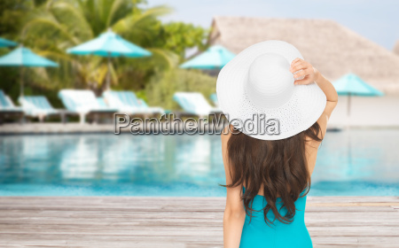 woman in swimsuit and sun hat
